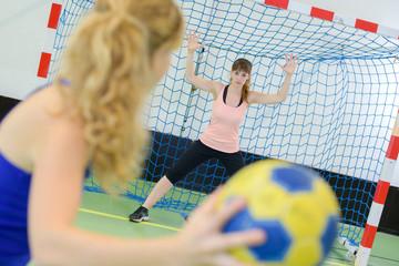 womans handball shooting practice
