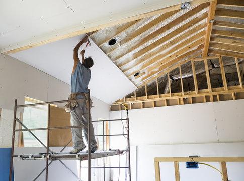 Construction Worker putting up Sheetrock