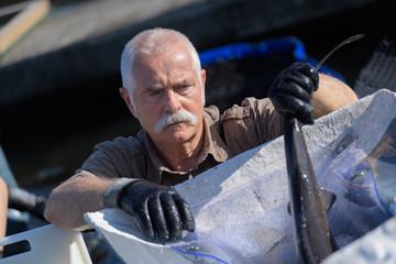 man working at a fishfarman