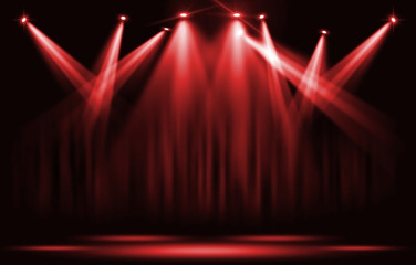 Stage lights. Red spotlight with certain through the darkness.