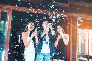 Celebration party group of asian young people holding confetti happy and funny concept