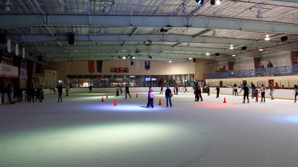 Evening at a crowded local Skating Rink