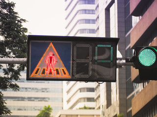 Traffic lights with crosswalk sign and the green light lit in city, Bangkok, Thailand