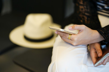 close up focus woman hand checking flight schedule in airport,business traveling concept