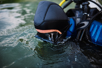 Diver in swimming mask looking underwater
