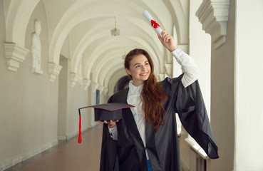Happy woman student in bachelor gown with diploma. Graduation day, University, education and happy people - concept.