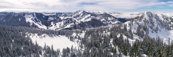 Helicopter Over Winter Mountian Sports Destination in Pacific Northwest Forest