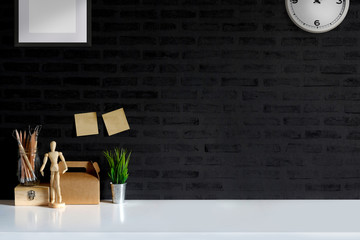 Stylish or designer minimalistic workplace with supplies , brushes, office plant. copy space for product display montage.