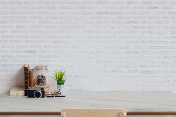 Stylish minimalistic white table workplace with supplies , vintage camera, house plant. copy space for product display montage.
