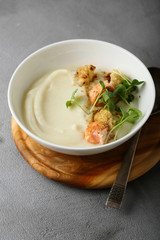 Cream-soup with salmon in bowl