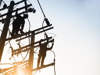 Electricity Power Line Lineman repair work Silhouette man working