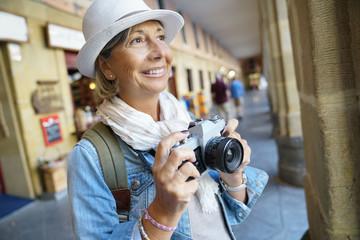 Senior woman taking pictures on tourist journey
