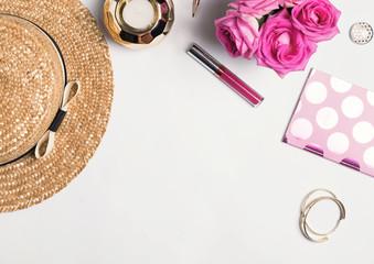 Stylish feminine accessories on the white