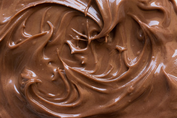 chocolate hazelnut spread on plate. Close up and background