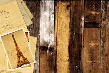 Retro grunge cards with landmarks of Paris on wooden planks
