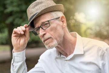 Mature man wearing a hat, light effect