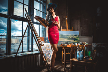 Young woman painter in her studio make some art