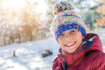 Boy playing in big snow in winter.