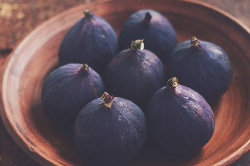 Ripe fall figs in a clay bowl