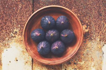 Purple figs with copy space on metal rustic background