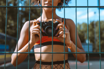 sportive woman with camera