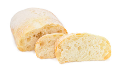 Partly sliced ciabatta on a white background