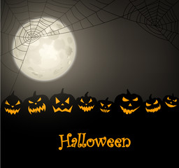 Halloween background with pumpkins and spiderweb.