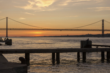 ponte 25 de abril bridge lisbon portugal in the evening