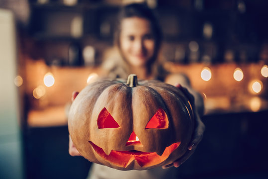 Woman with Halloween pumpkin