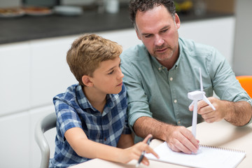 Father helping son with school project