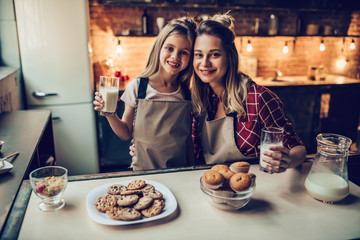 Mom with daughter on kitchen