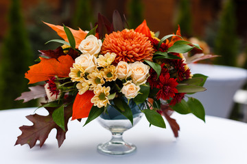 autumn bouquet in a vase on a white table