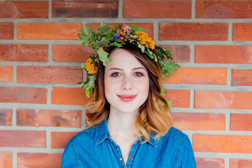 Redhead girl with oak leaves wreath at Germany Unity day