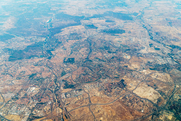 Airplane View Of City And Earth Horizon