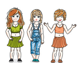 Beautiful little girls group posing wearing fashionable casual clothes. Vector kids illustrations set.