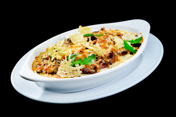 Tasting and appetizing traditional Italian lasagna dish with mushrooms with fresh dill Autumn menu in an Italian restaurant. Hotel service photo background