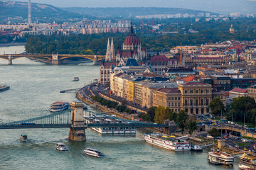 Budapest, Hungary - Panoramic skyline view at sunset of the famous Szechenyi Chain Bridge, Margaret Bridge, Margaret Island and Parliament of Hungary with Buda Hills at background with colorful sky