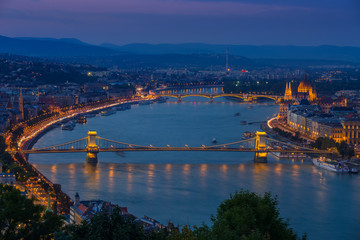 Foto op Plexiglas Historisch geb. Budapest, Hungary - Panoramic skyline view at blue hour of the famous Szechenyi Chain Bridge, Margaret Bridge, Margaret Island and Parliament of Hungary with Buda Hills at background with colorful sky