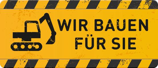 gelbes Schild Wir bauen für Sie mit Bagger-Icon