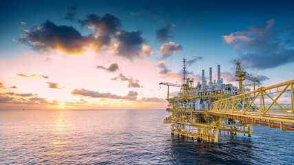 Panorama of Oil and Gas central processing platform in sunset, offshore production and exploration business in the gulf of Thailand.