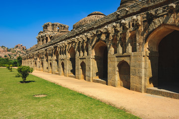 Fototapete - Ancient ruins in Hampi, Karnataka, India. Elephant Stables in Royal Centre, is located in the area that lies just outside the Zenana Enclosure.