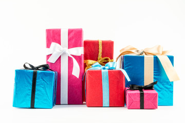 Big pile of colorful wrapped gift boxes isolated on white background. Mountain gifts. Beautiful present box with overwhelming bow. Christmas surprise icon. Happy new year decor, discounts, promotions.