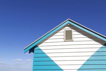 Beach hut on Melbourne's iconic Brighton Beach, Australia with a blue sky background