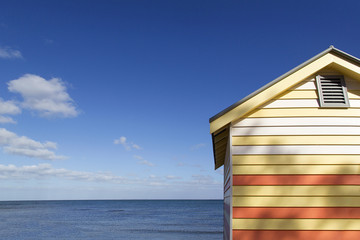 Ocean view from Brighton Beach in Australia with an iconic beach hut