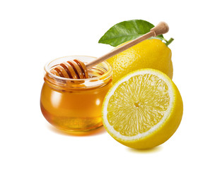Remedy for flu and cold treatment - honey jar plus lemon isolated