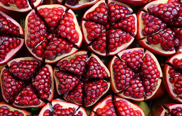 Pomegranate slices and seeds.