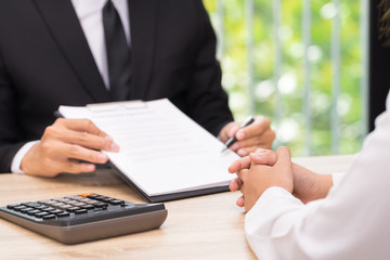 Customer or woman make a decision to sign a contract when businessman giving pen