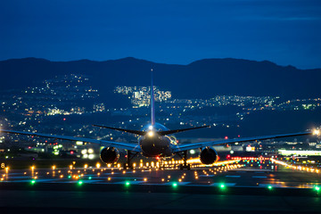 Boeing airplane taking off from the airport in the night. (夜のボーイング機離陸シーン)