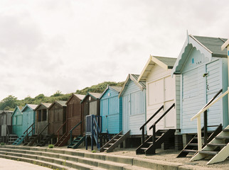 Beach huts in a row at Frinton, Essex