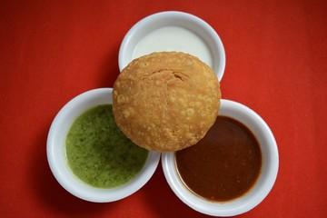 Indian Kachori with chutneys top view